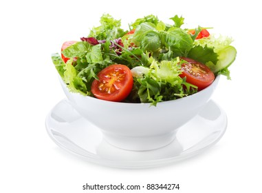 salad with greens and vegetables on white background