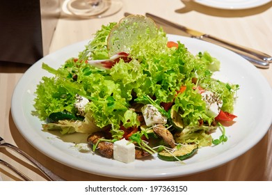 Salad with grilled meat and vegetables and fetta cheese on restaurant