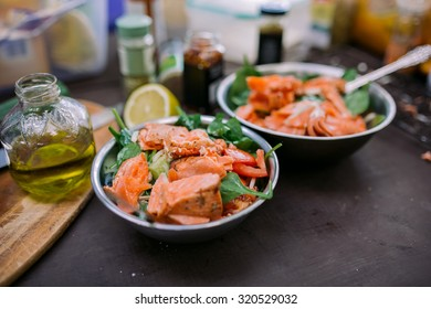 Salad with grilled salmon in a camping aluminum dish