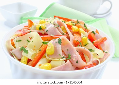 Salad with ham, paprika, corn and cheese
