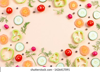 Salad ingredients layout. Food pattern with cherry tomatoes, carrot, cucumbers, radish, greens, pepper and spices