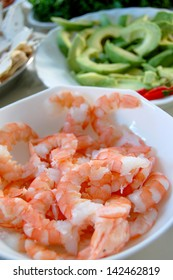 Salad ingredients - shrimps, avocados and cold cuts
