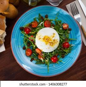 Salad with Italian burrata cheese; arugula and cherry tomatoes