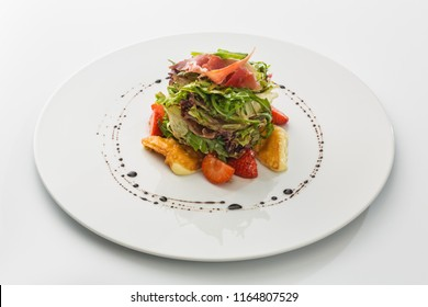 salad with jamon, strawberries and greens isolated on white background.