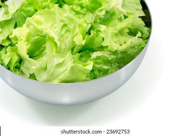 Salad leaves in a metal bowl isolated on white