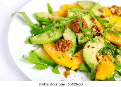 Salad with mango, avocado, arugula and walnuts