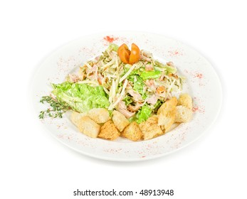 salad of meat, vegetable and dried crust dish on a white background