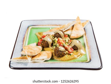 Salad with meat and vegetables in square plate on white background. Isolated on white