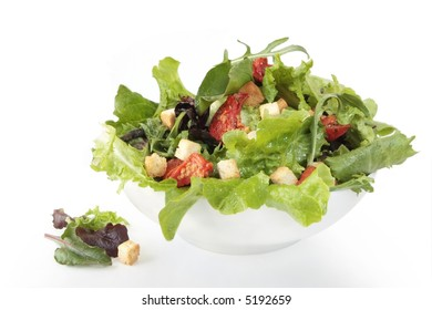 Salad with mixed lettuce leaves, sundried tomatoes, and croutons.
