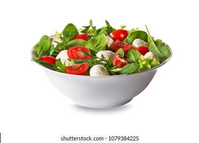 Salad with mozzarella cheese, arugula and tomato isolated on white background