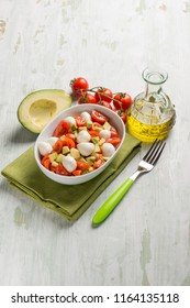 salad with mozzarella tomatoes and avocado