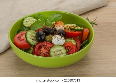 Salad with mozzarella and tomatoes on the board