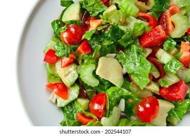 salad with olive oil isolated on white background