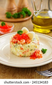 "Salad ""Olivier"" with crayfish and caviar."