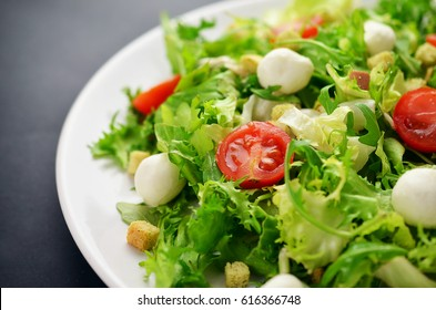 Salad on black table