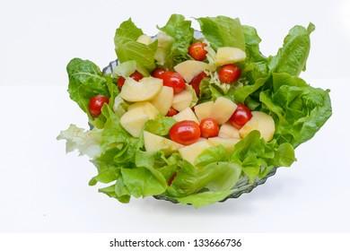 Salad on dish isolate on white background.
