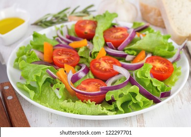 salad with onion on the plate and oil