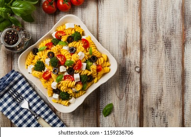 Salad with pasta and feta cheese. Top view. Flat lay.