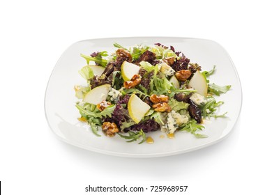salad with pear and walnuts on a white background