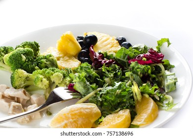 salad plate with fruit, vegetables and chicken