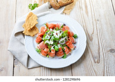 Salad plate with South Tyrolean bacon, served with parmesan cheese and rye bread