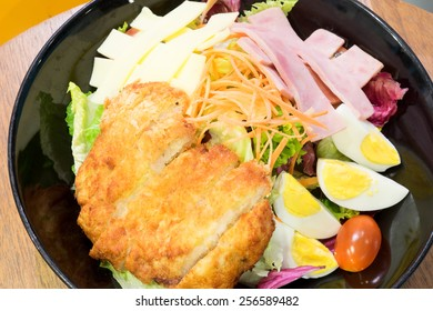 salad pork with ham, egg and cheese