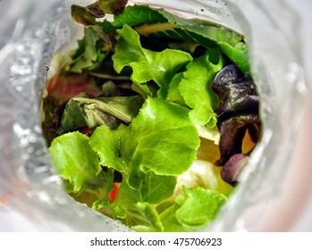 Salad in a PP bag. Shot from above of the opened bag.