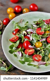salad with purslane and cherry tomatoes.  concept of organic food from the environment. edible weeds and grass. Purslane is a useful herb.