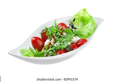 salad with quail eggs isolated on a white background