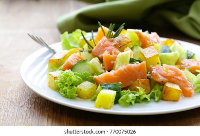 salad with red fish, potatoes and fresh cucumbers