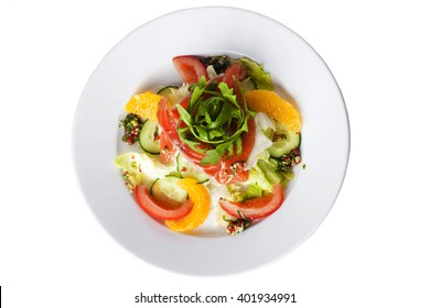 salad with red fish, tomatoes, cucumbers and oranges on a white background