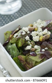 Salad with red and green lettuce vinaigrette nuts berries and blue cheese