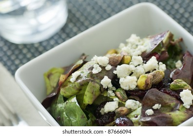 Salad with red and green lettuce vinaigrette nuts cranberry and blue cheese