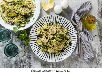 salad with rice with zucchini, avocado, olives and capers. healthy spring summer vegan cuisine recipe for the whole family or party