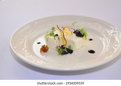 Salad with roasted beetroot, pea, soft goat cheese isolated on white background side view