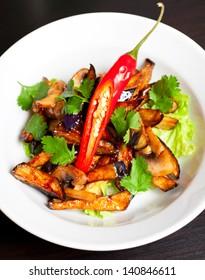 Salad from roasted eggplants, mushrooms