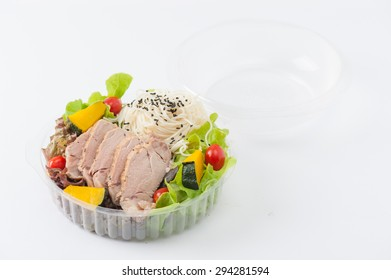 Salad with roasted pork and soba noodles by clean food concept in lunch box
