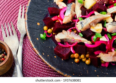 Salad with salted herring,beets,onions and green peas.