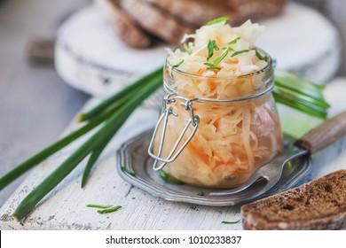 salad sauerkraut in a glass jar on a table