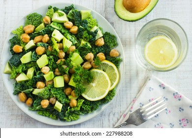 Salad with savoy cabbage, avocado and chickpeas, top view