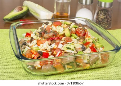 salad of several components in a glass salad bowl