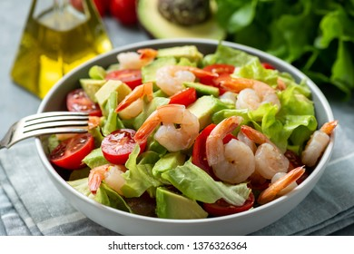 Salad with shrimps, avocado and cherry tomatoes.