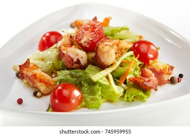Salad with shrimps, bacon and vegetables with fresh herbs and spices