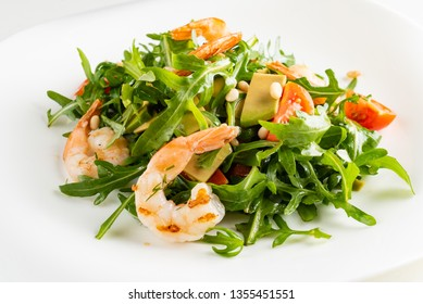 salad with shrimps, rocket salad and cherry tomatoes