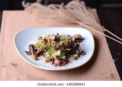 salad with small octopuses, capers and parmesan cheese