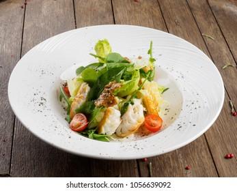 Salad with smoked cod.