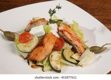 Salad with smoked salmon and Zucchini on plate