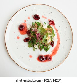 Salad with soft cheese and cherry dressing shot from above
