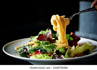 Salad spaghetti, lettuce and cheese