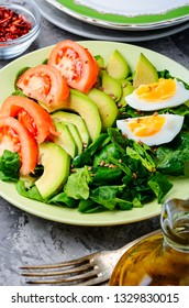 Salad with spinach, avocado, greens and egg.Spring salad.Colorful summer salad